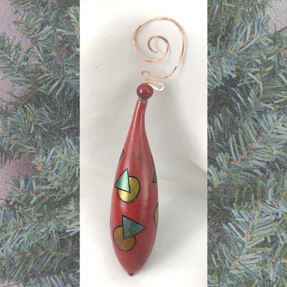 Gourd Christmas ornament with geometric pattern burned and dyed with pounded copper hanger