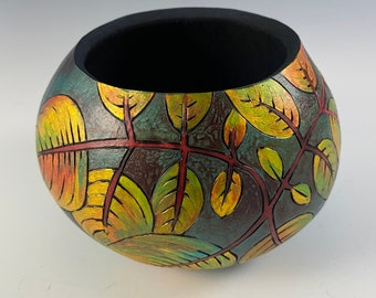 Small gourd vessel burned and dyed, geometric pattern in blue, gold, and yellow