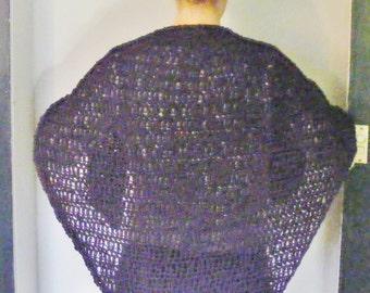 Ladies purple crochet shawl.