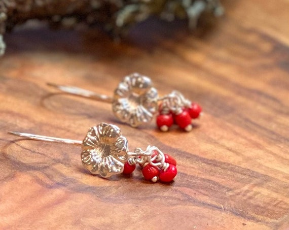 Silver flower drop style earring with earthy red beads