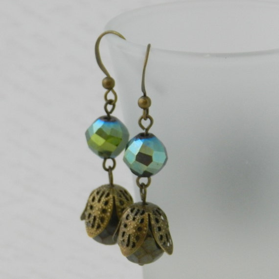 Glass bead earrings in metallic bronze green and metallic mossy green with filigree bead cap
