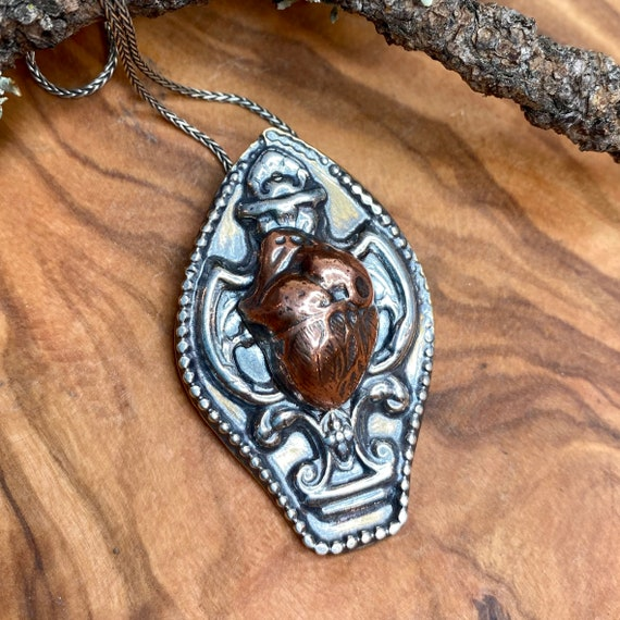 Awesome gothic anatomical heart pendant