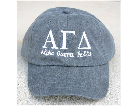 Alpha Gamma Delta script with BIG and LITTLE added to the back of baseball cap
