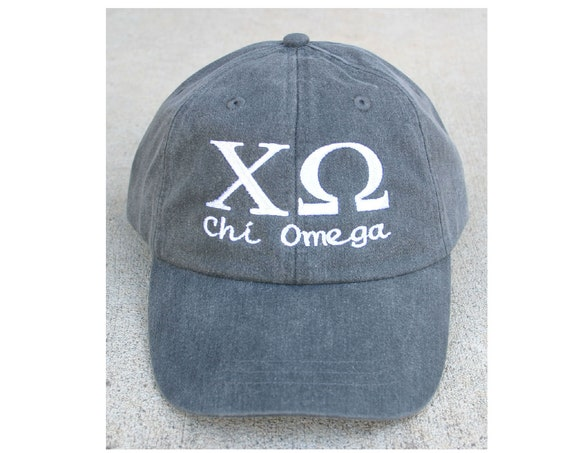 Chi Omega script with BIG and LITTLE added to the back of baseball cap