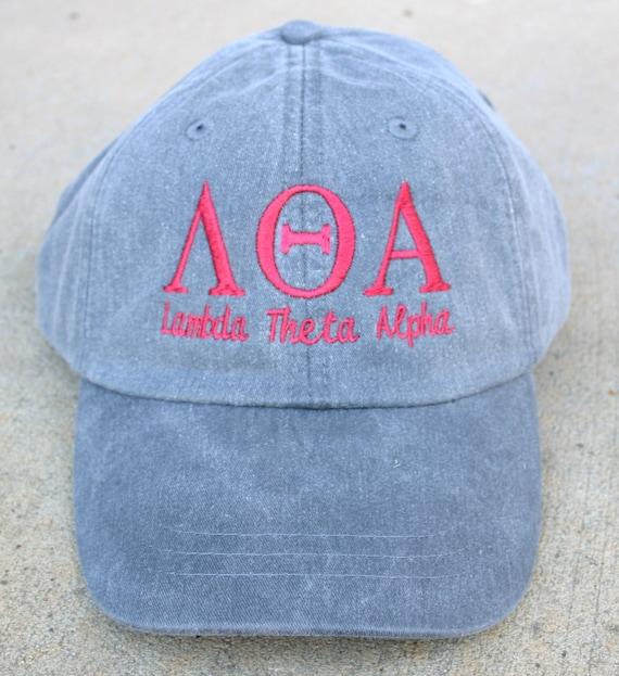 Lambda Theta Alpha with script baseball cap
