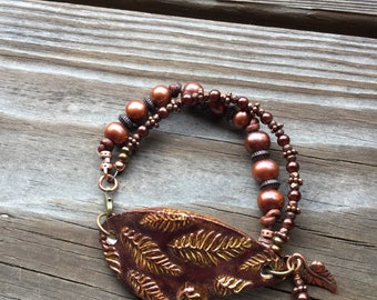 Ceramic leaf double strand bracelet