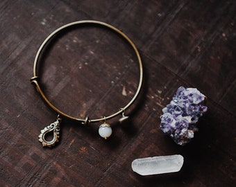 indra. a boho adjustable antiqued brass bangle charm bracelet