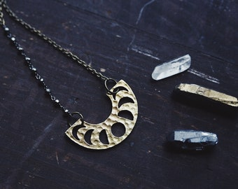 ayla. a boho hammered brass moon phase and pyrite statement necklace