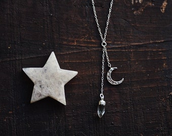 elara. a dainty celestial sterling silver hammered crescent moon and polished crystal quartz point dangle y necklace