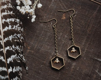 the beekeeper. a pair of modern geometric boho nature inspired brass hexagon honeycomb and tiny bee drop earrings