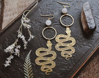 botanical snake. a pair of boho quartz and etched snake earrings.