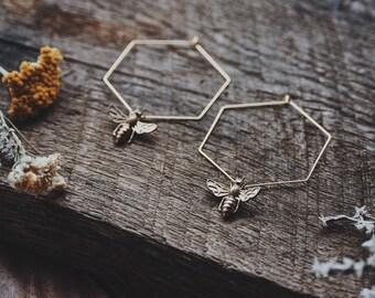 honey queen. a pair of brass hexagon hoop and bee earrings