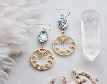 celestial ocean. a pair of bohemian abalone moon phase and sun earrings