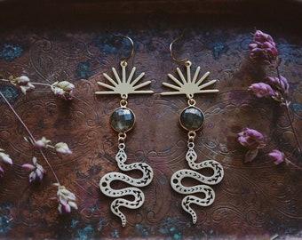 celestial serpent. a pair of bohemian labradorite sun and moon phase snake earrings