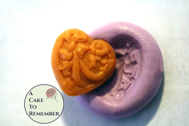 3828282df Little silicone heart mold for cake decorating or cupcake