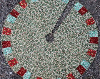 A Ribbon & Holly Masterpiece Quilts Christmas Tree Skirt II