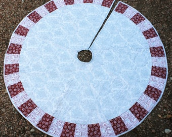 A Silver & Burgundy Masterpiece Quilts Christmas Tree Skirt