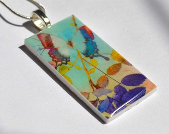 A Blue Butterfly Resin Pendant with a Silver Snake Chain and a Sterling Silver Bail OR as a Keyring.