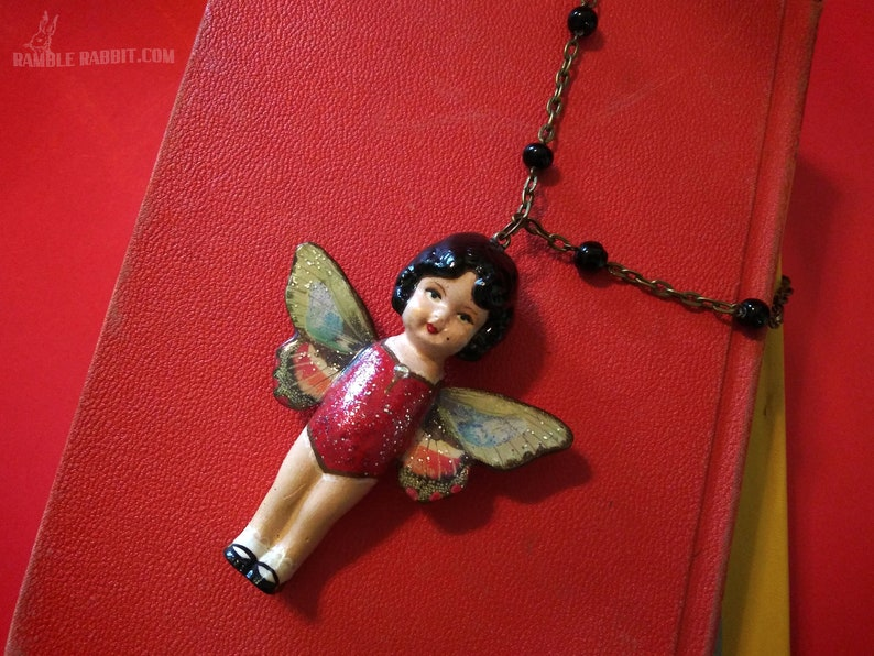 Handmade Butterfly Kewpie Necklace Hand Cast Repaint Doll image 0