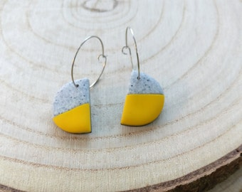 Half moon polymer clay earrings on hoop, yellow side of the moon