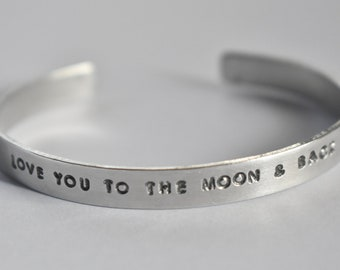love you to the moon and back - Hand Stamped Silver Tone Phrase Bracelet Cuff