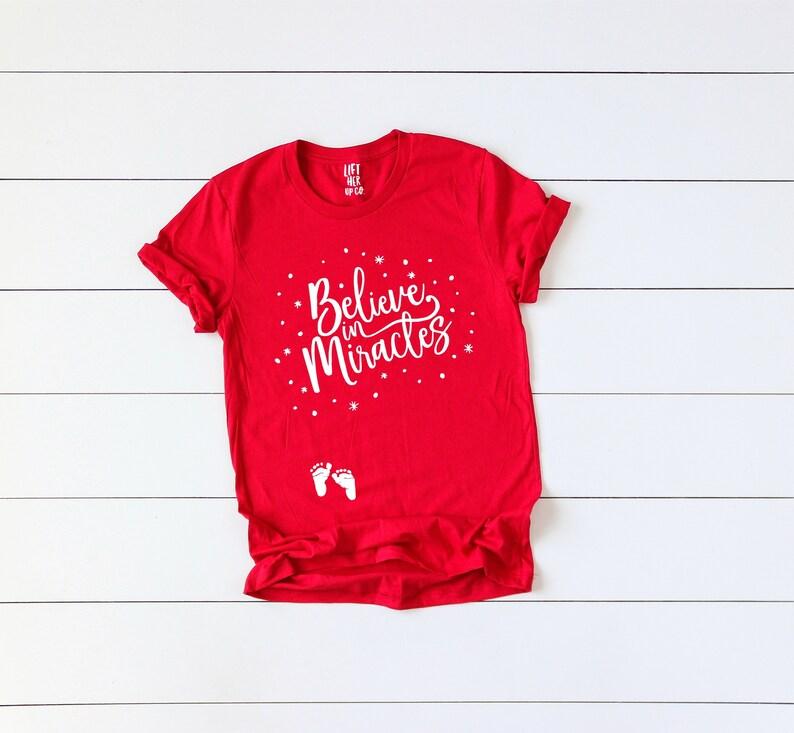 225da6ba736d Christmas pregnancy announcement shirt // believe in miracles | Etsy