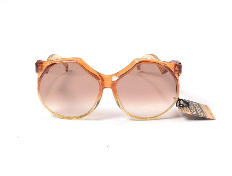 vintage 60s 70s sunglasses clear orange plastic frame brown tint lens Foster Grant oversize bug eye bugeye 1960 1970 fashion style NOS