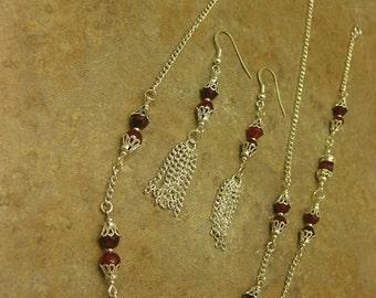 ruby bracelet, ruby necklace, ruby earrings, red ruby jewelry, silver jewelry, silver bracelet, bracelet, silver earrings