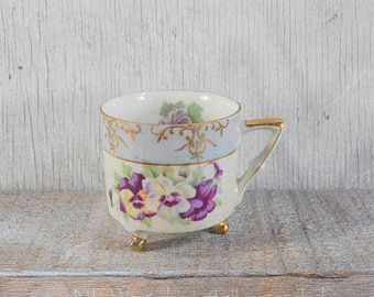 Vintage footed teacup without matching saucer, purple pansies, gold detailing