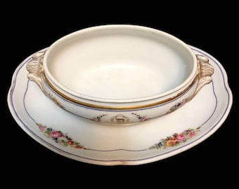 A La Ville De Sevres Mace Sauce Tureen with attached underplate, handpainted flowers and gilt, monogrammed 'D', early 20th Century