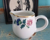 Sweet little china creamer with gold trim and lovely floral design Syracuse china