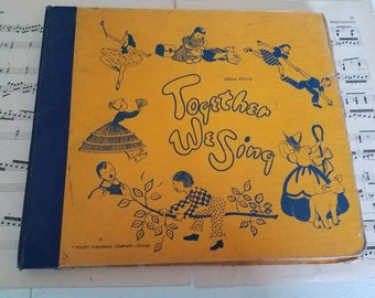 Vintage children's record album with 4 records 78 RPM