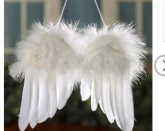 White Feathered angel wings portrait . craft ,centerpeice