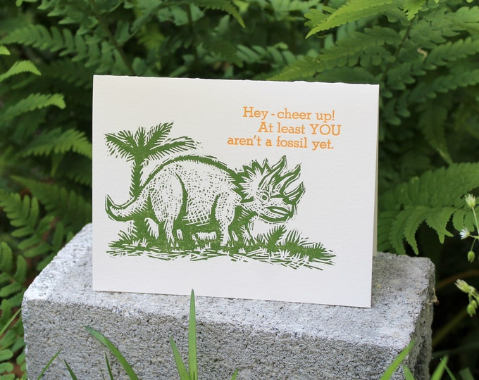 """Letterpress Happy Birthday Card with Dinosaur: """"At least YOU aren't a fossil yet!"""""""