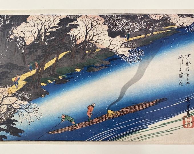 Utagawa Hiroshige. Famous Places in Kyoto. Cherry Blossoms in Full Bloom at Arashiyama (Arashiyama manka) Japanese Ukiyo-E. Woodblock Print.