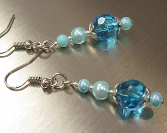 Dangling earrings in skyblue with glass beads