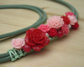 Green lariat necklace of cord with embroidered flowers