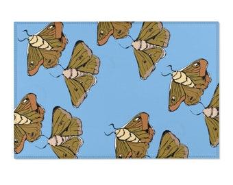 Moth Babies - Blue Area Rug