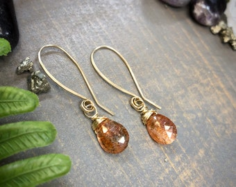 Sunstone wrapped in 14k gold filled on simple long ear wires. Earrings handmade with love by Gypsy Lotus