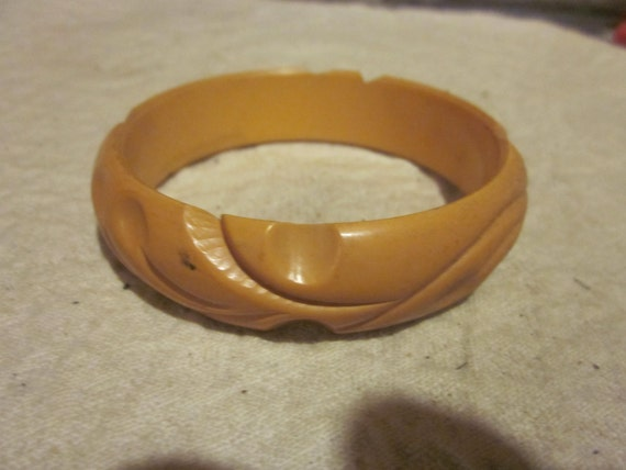 carved butterscotch bakelite bangle bracelet, bake
