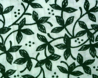 Vintage 1970s quilting sewing fabric in highquality unused cotton with small darkgreen leafe pattern on bone white bottomcolor