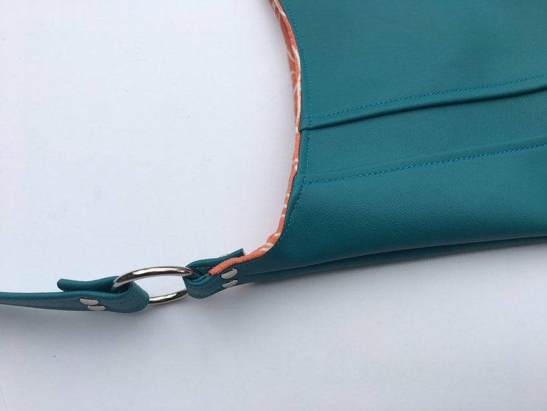 snap closure choose interior color or pattern statement purse turquoise leather vinyl modern diaper bag. tote bag