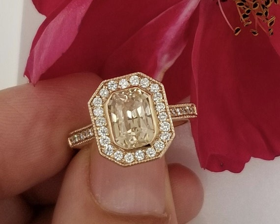 Peach Sapphire 2.43ct Mounted in a Rose Gold Vintage Diamond Halo