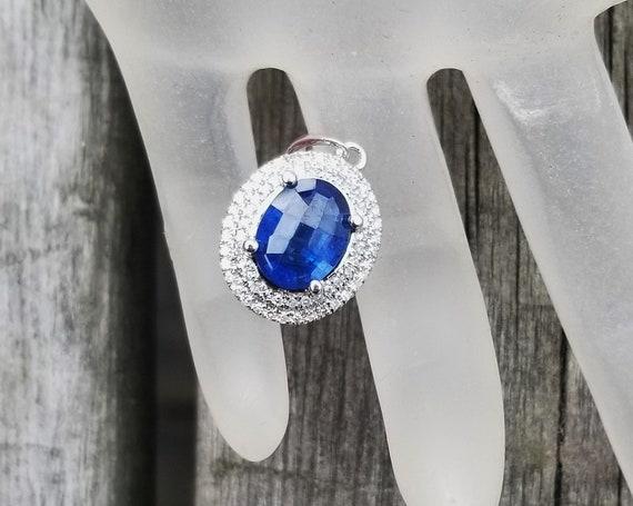Checkerboard 9x7MM Oval Blue Sapphire in 14K White Gold Diamond Halo