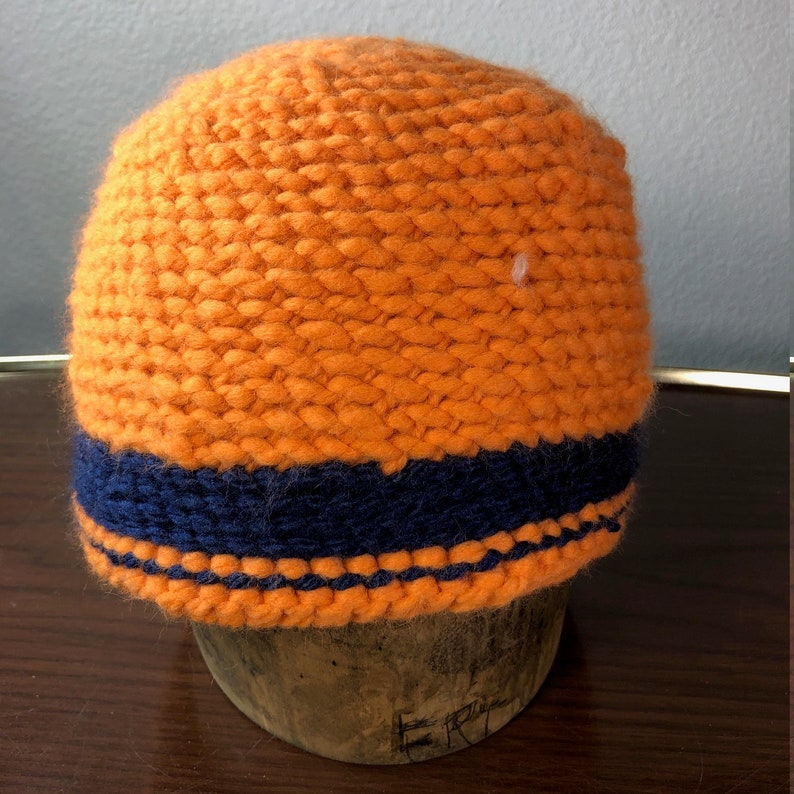 Bright orange with a snazzy blue stripe hat image 0