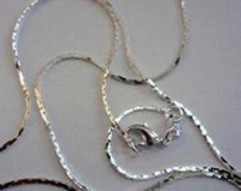 A pretty square 63cm silver-plated chain