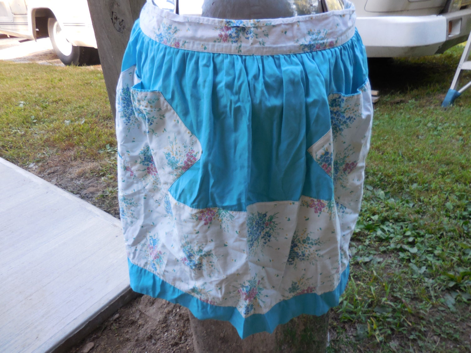 Vintage Aprons, Retro Aprons, Old Fashioned Aprons & Patterns Vintage 1950S To 1960S Teal Blue  White Half Apron With Tie Floral Design PinkBlueYellowGreen $14.99 AT vintagedancer.com