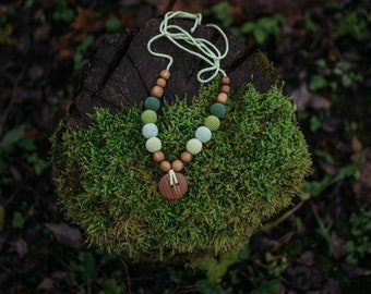 Handmade wooden and cotton necklace.
