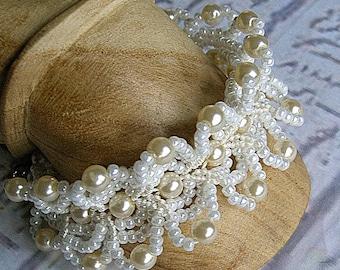 Pearl bracelet cuff in micro macrame with vintage pearls. Handmade wedding jewelry.