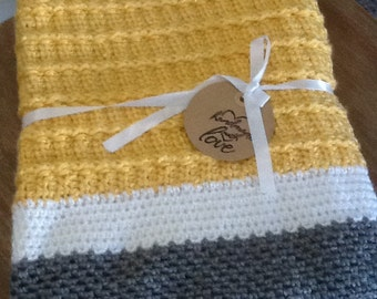 Goldenrod yellow, gray, and white blanket